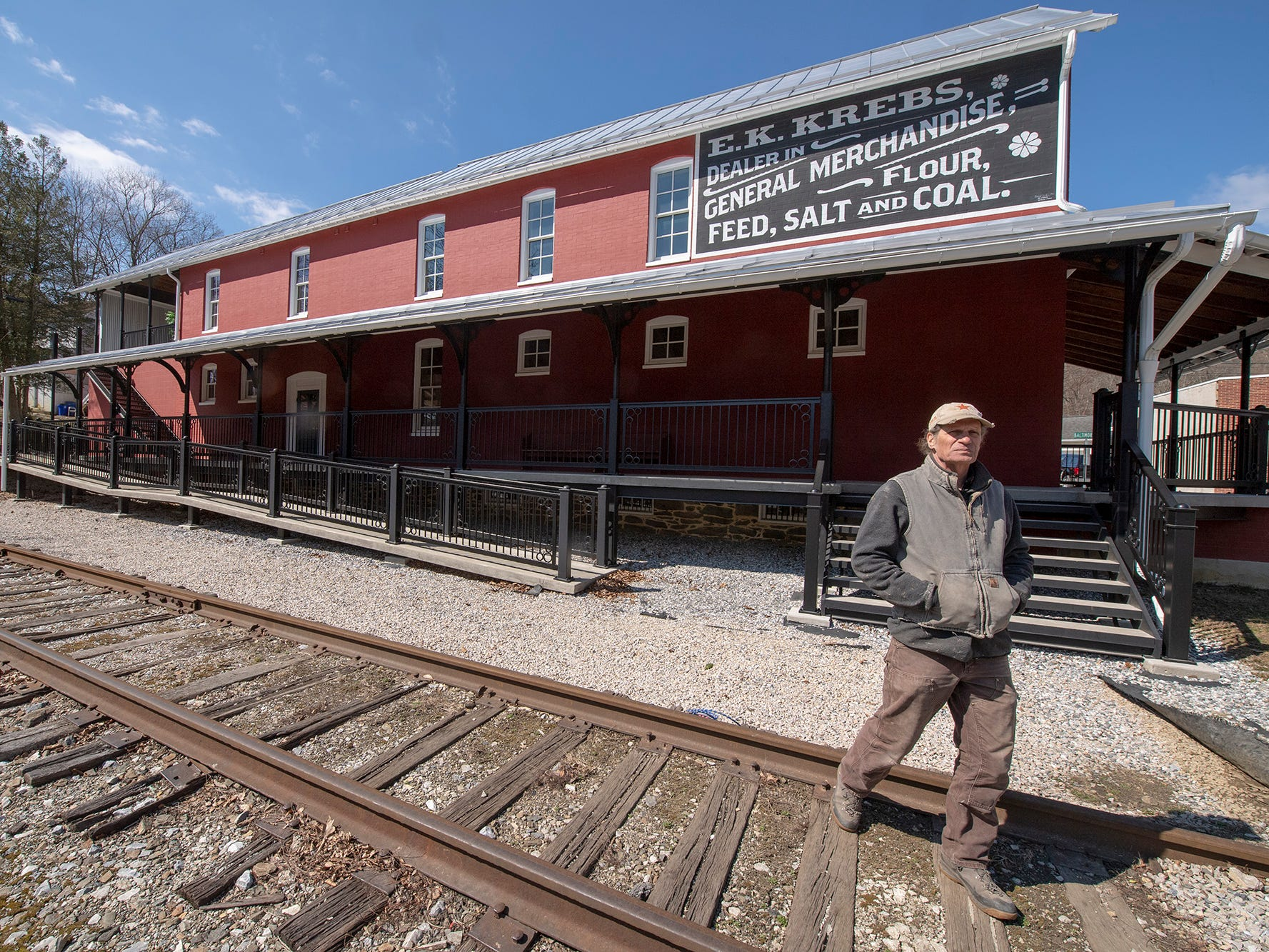 David Keller walks across the railroad tracks in front of the Seitzland store outside of Glen Rock.