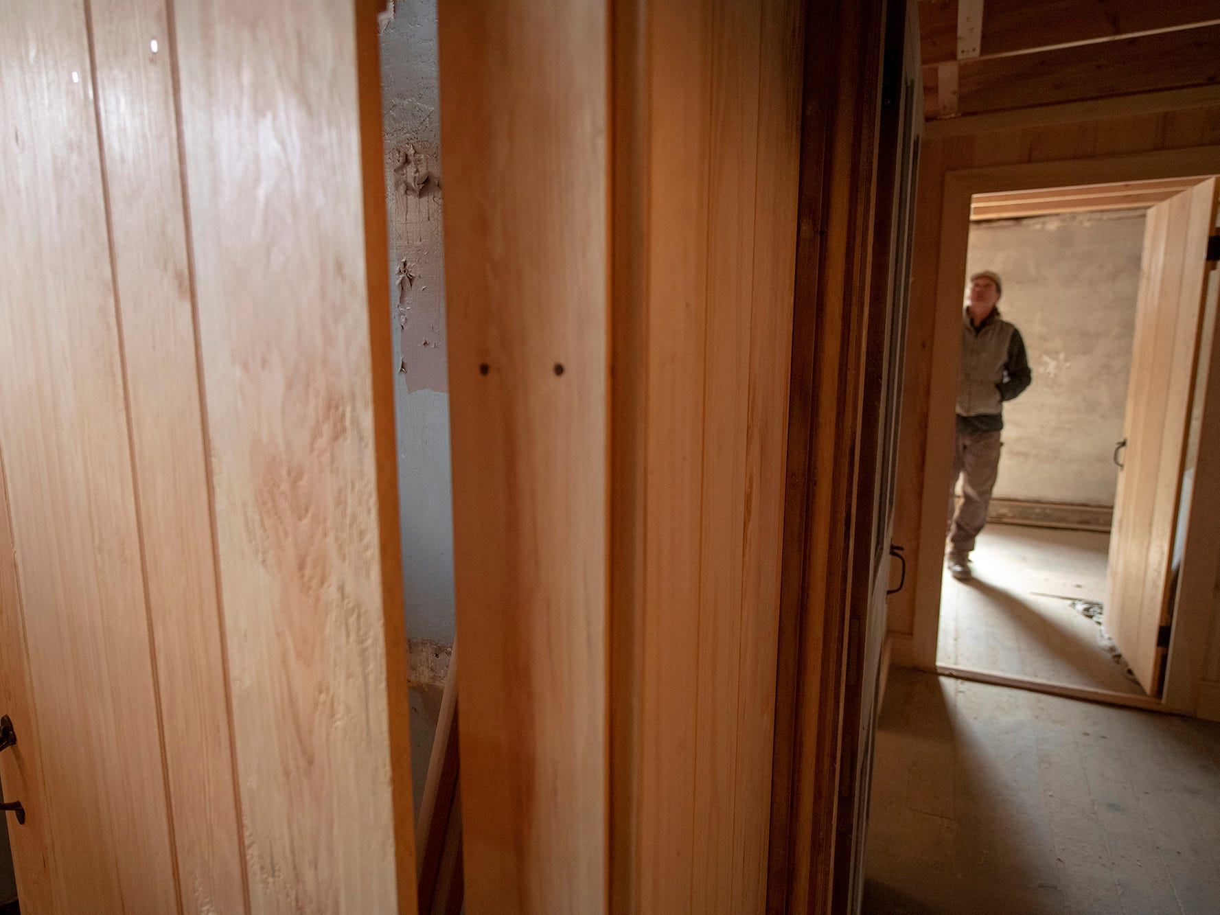 David Keller stands in a room of the stone home in Seitzland Village outside of Glen Rock. He has milled the wood for many of the doors and woodwork using traditional methods that match the vintage of the house.