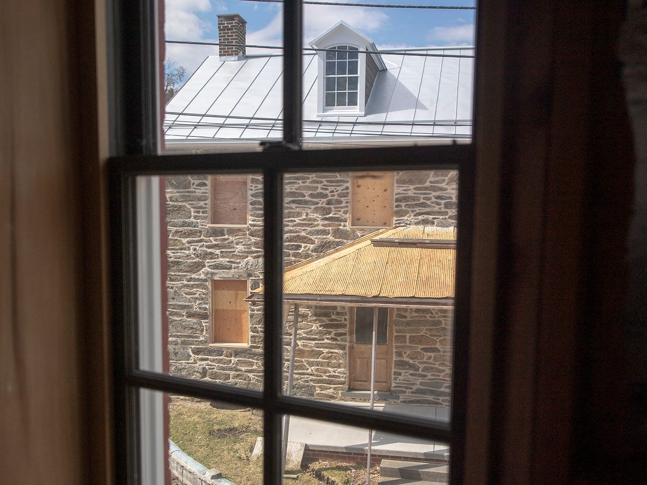 This is looking out a second-floor window of the Seitzland store at the stone building also under renovation.