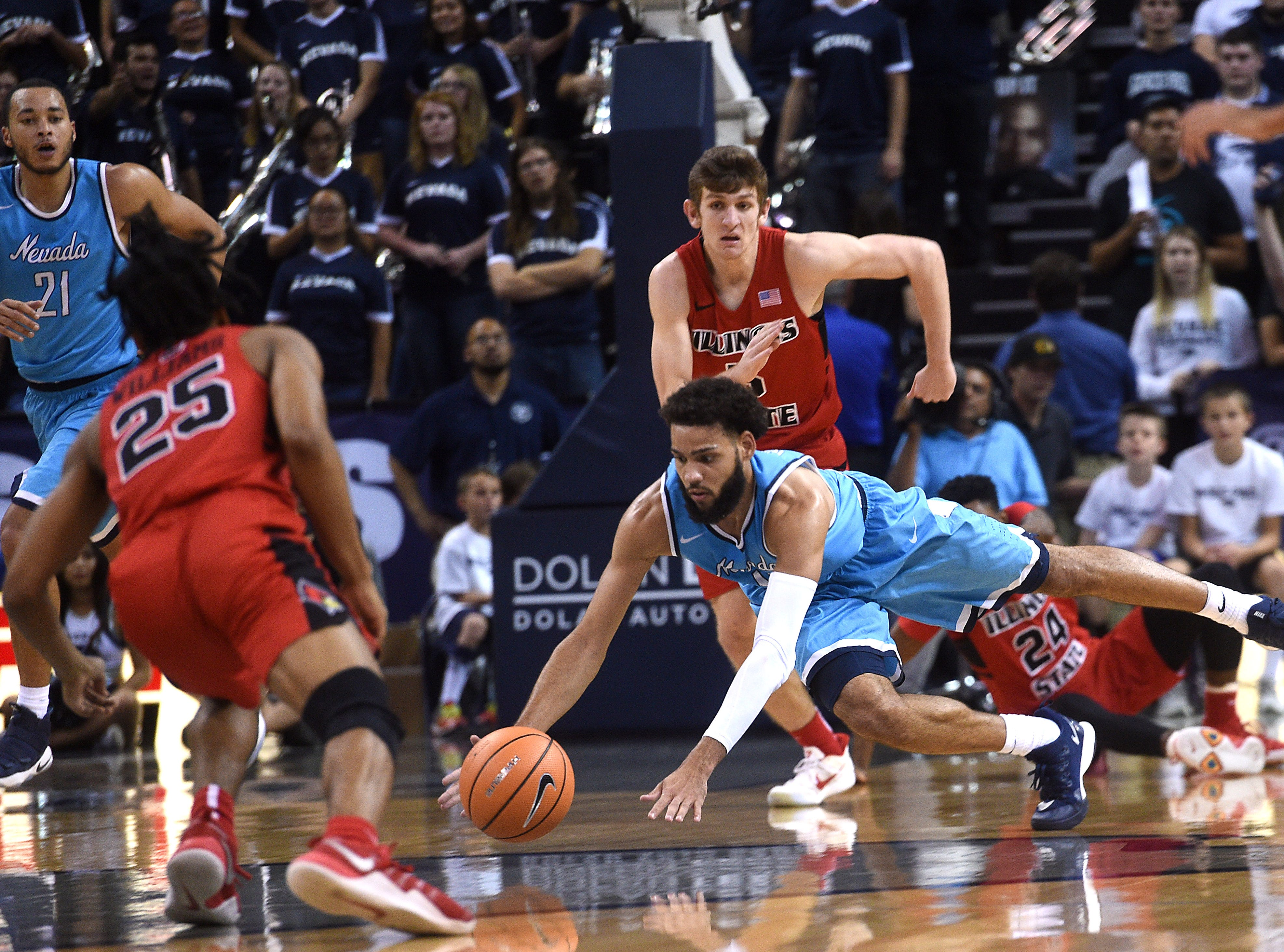 Nevada's Cody Martin dives for a loose ball while taking on Illinois State during their basketball game at Lawlor Events Center in Reno on Nov. 29, 2017.