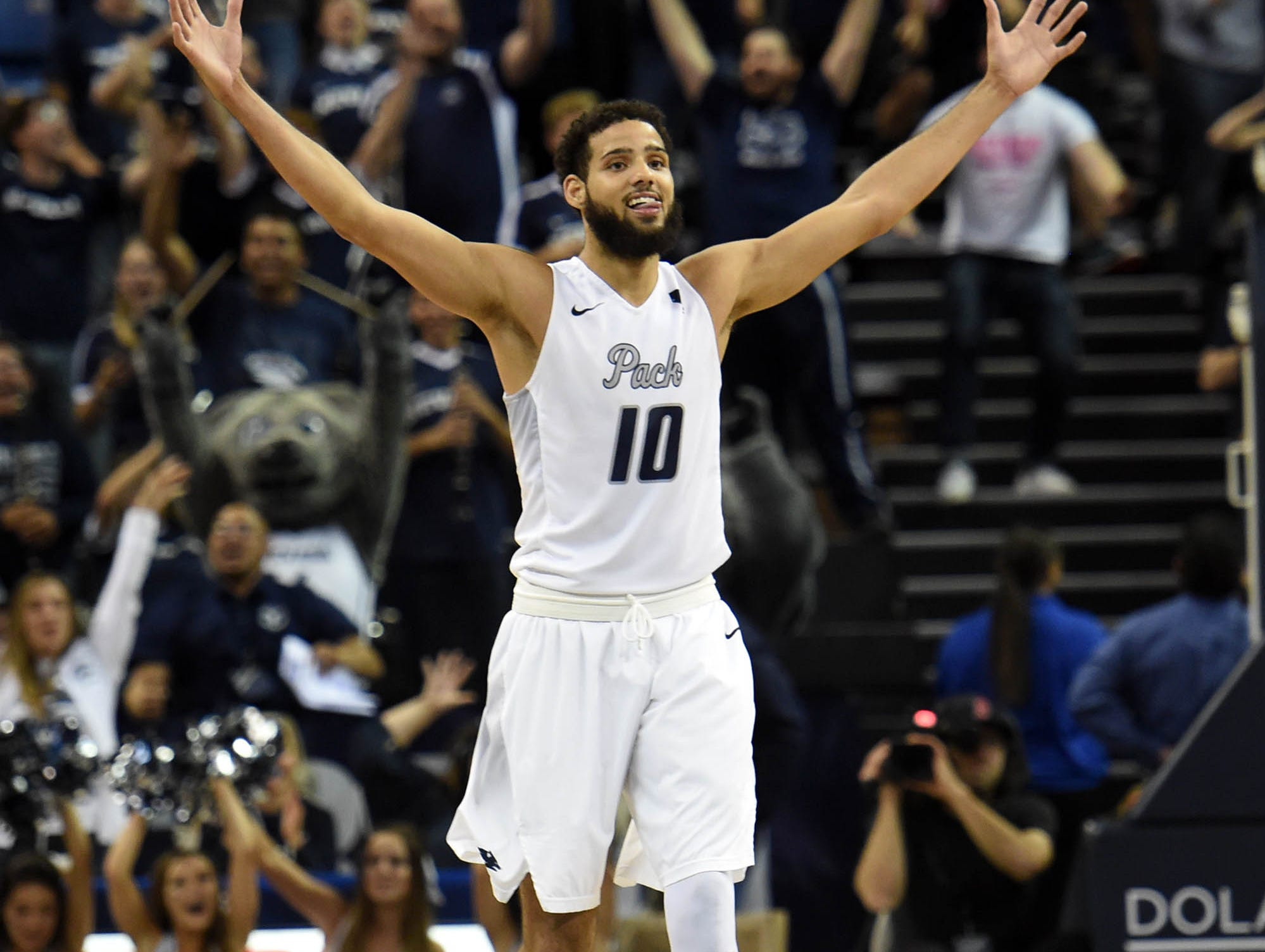Nevada's Caleb Martin celebrates his shot dropping in with a second left on the clock late in the second half of Monday's game against Rhode Island at Lawlor Events Center on Nov. 13, 2017. Nevada won 88-81.