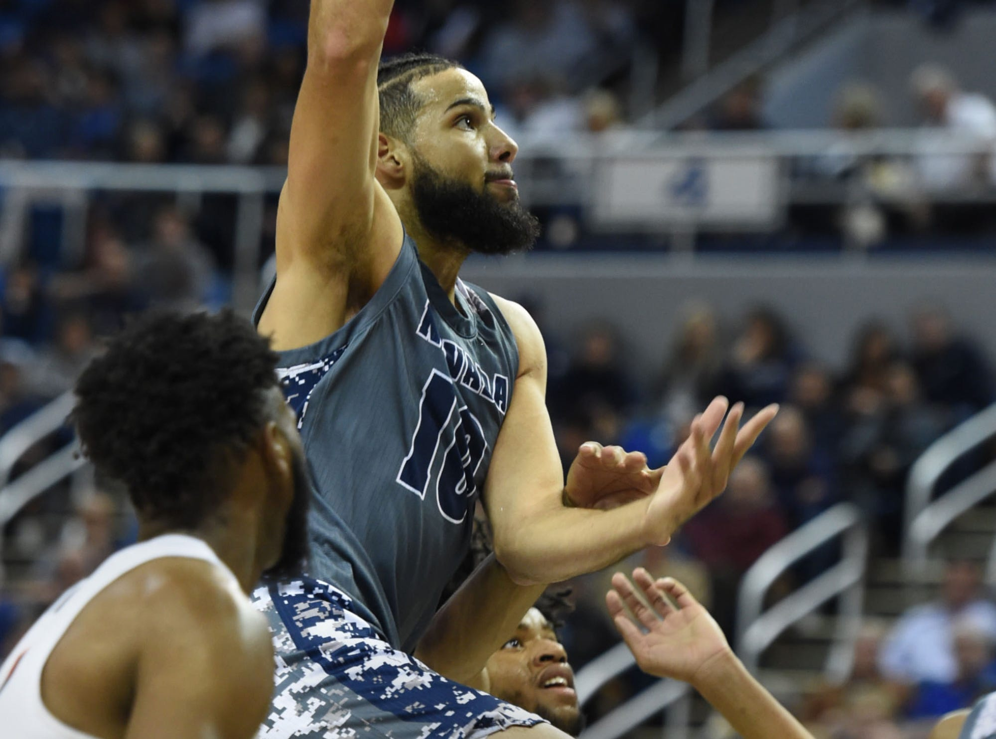 Nevada's Caleb Martin goes up to score against the Pacific Tigers at Lawlor Events Center on Saturday Nov. 10, 2018.