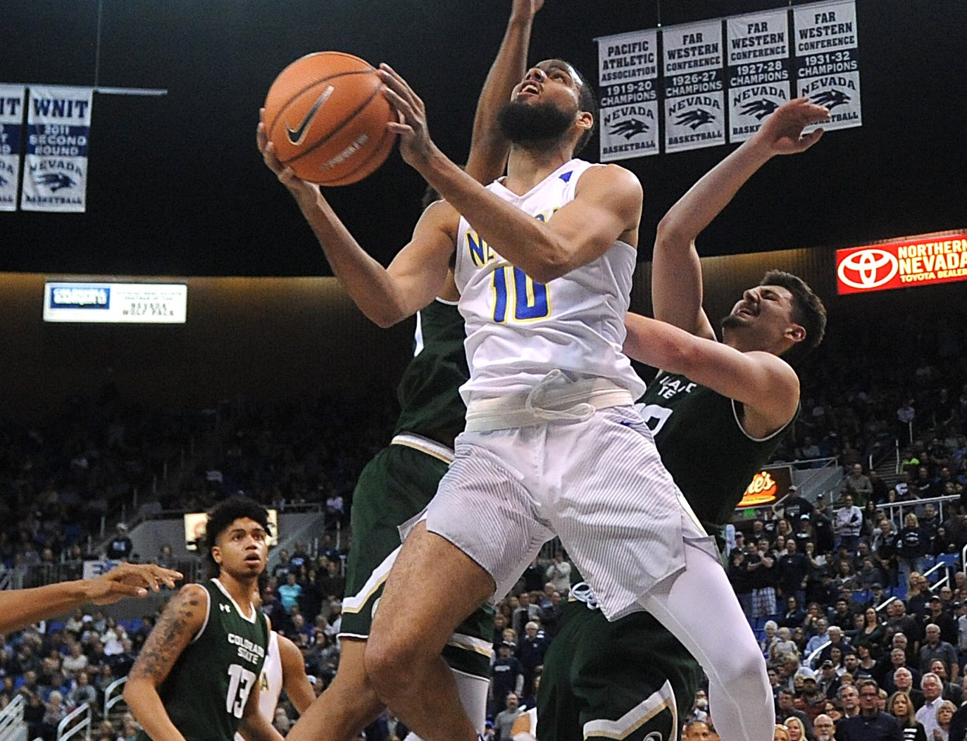 Nevada's Caleb Martin (10) drives to the basket while taking on Colorado State during their basketball game at Lawlor Events Center in Reno on Feb. 25, 2018.