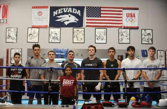 The Nevada boxing team poses for a group portrait in their training gym in Reno on Nov. 7, 2018.