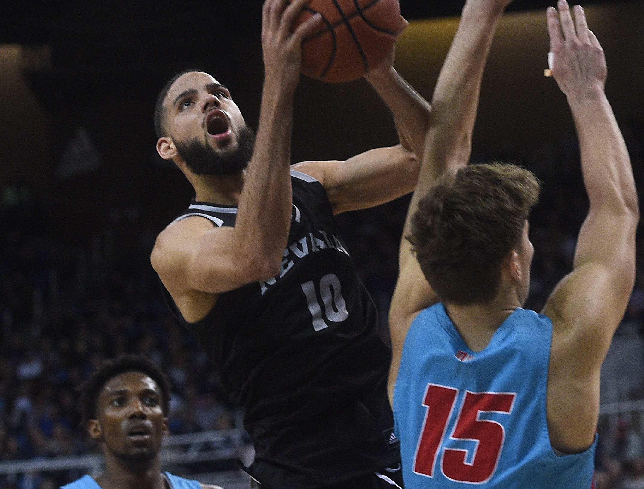 Nevada's Caleb Martin drives to the basket while taking on New Mexico at Lawlor Events Center in Reno on Feb. 9, 2019.