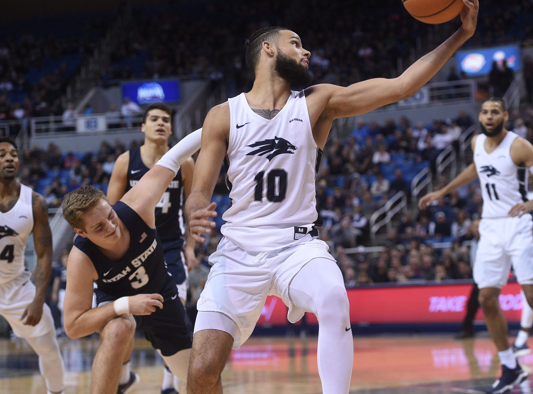 Nevada takes on Utah State during their basketball game at Lawlor Events Center in Reno on Jan. 13, 2018.
