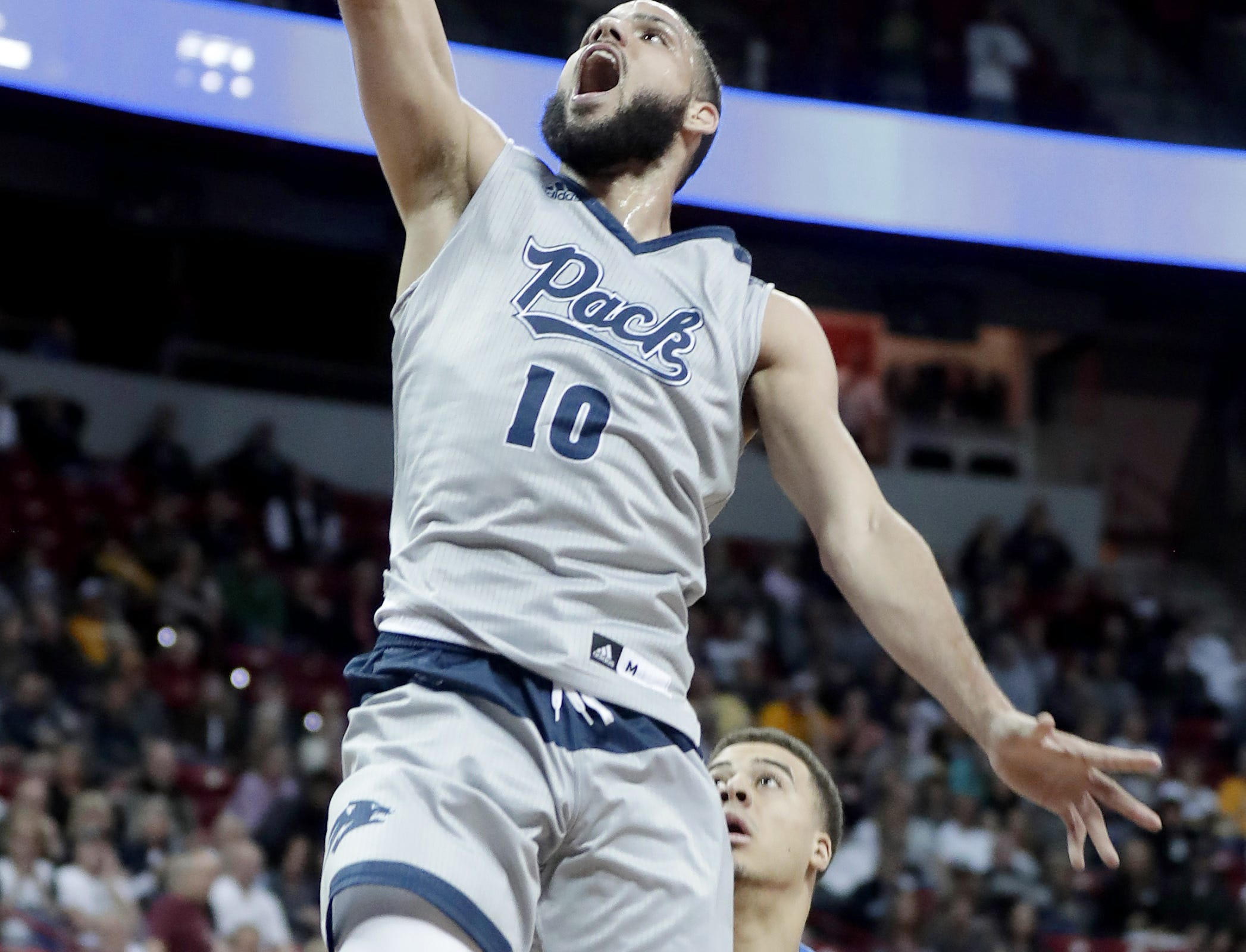 Nevada's Caleb Martin shoots during the first half of an NCAA college basketball game against Boise State in the Mountain West Conference men's tournament Thursday, March 14, 2019, in Las Vegas.