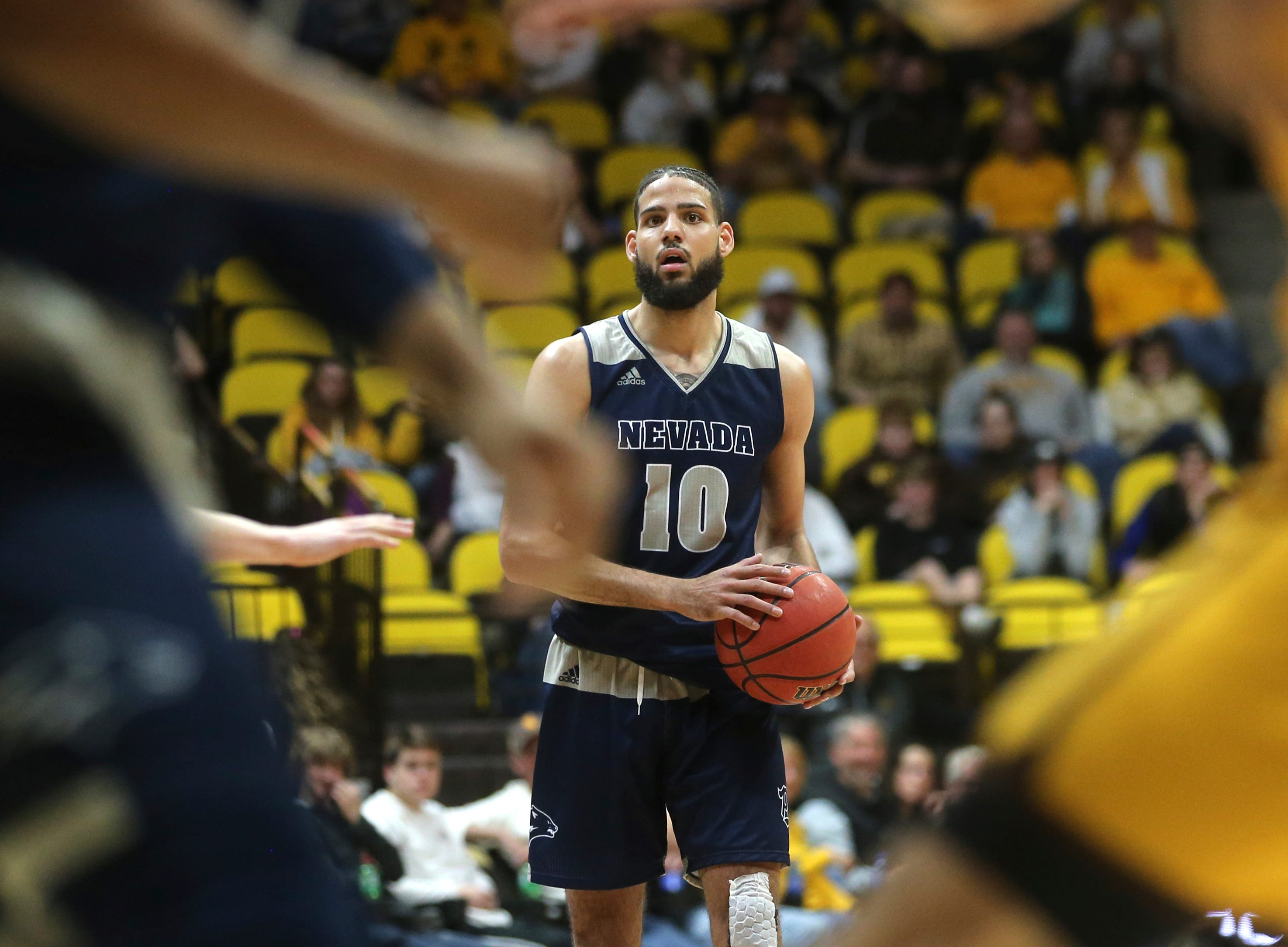 Nevada forward Caleb Martin (10) moves the ball down court during the second half of an NCAA college basketball game against Wyoming on Saturday, Feb. 16, 2019, in Laramie, Wyo.