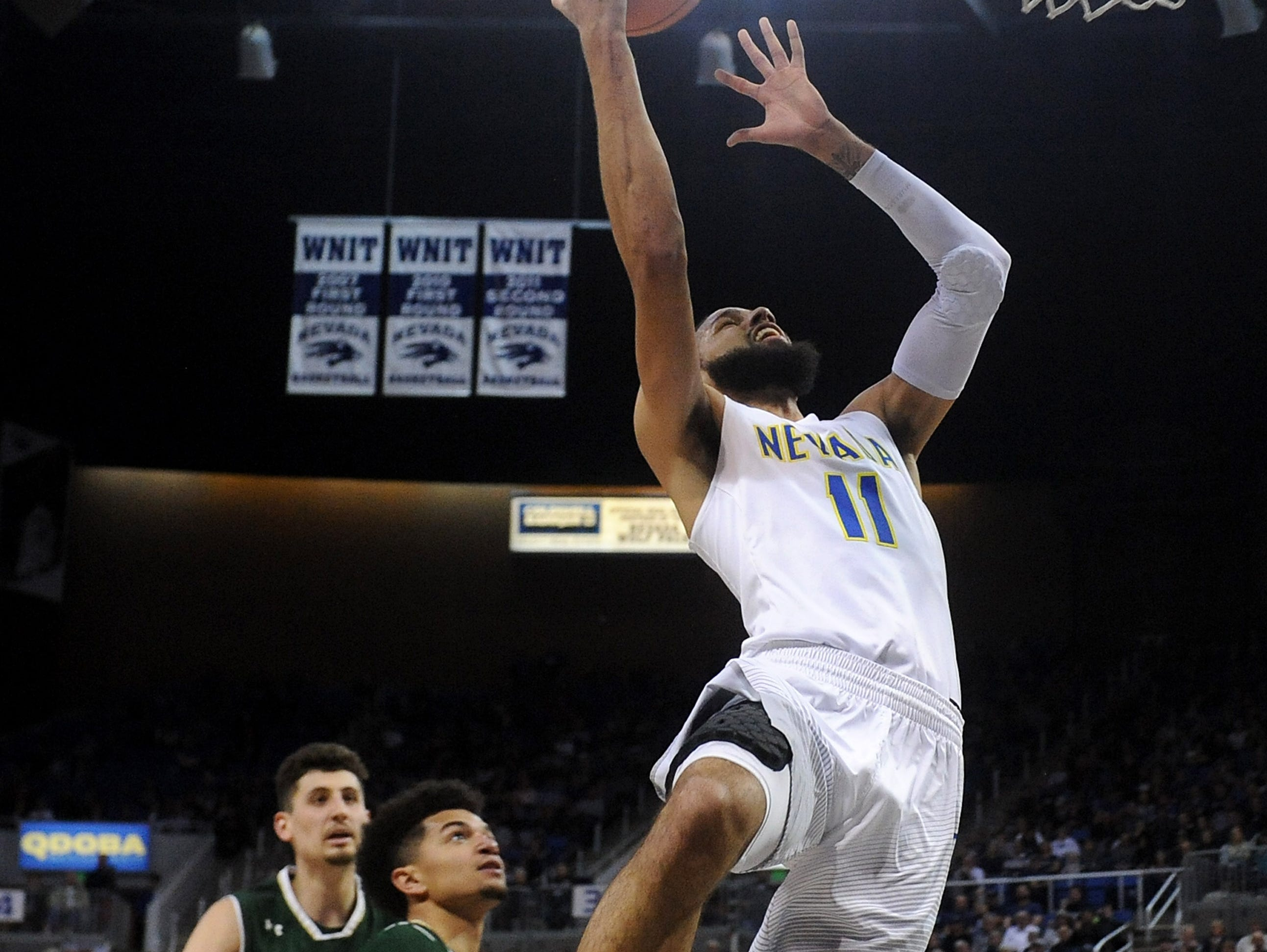 Nevada's Cody Martin (11) shoots while taking on Colorado State during their basketball game at Lawlor Events Center in Reno on Feb. 25, 2018.