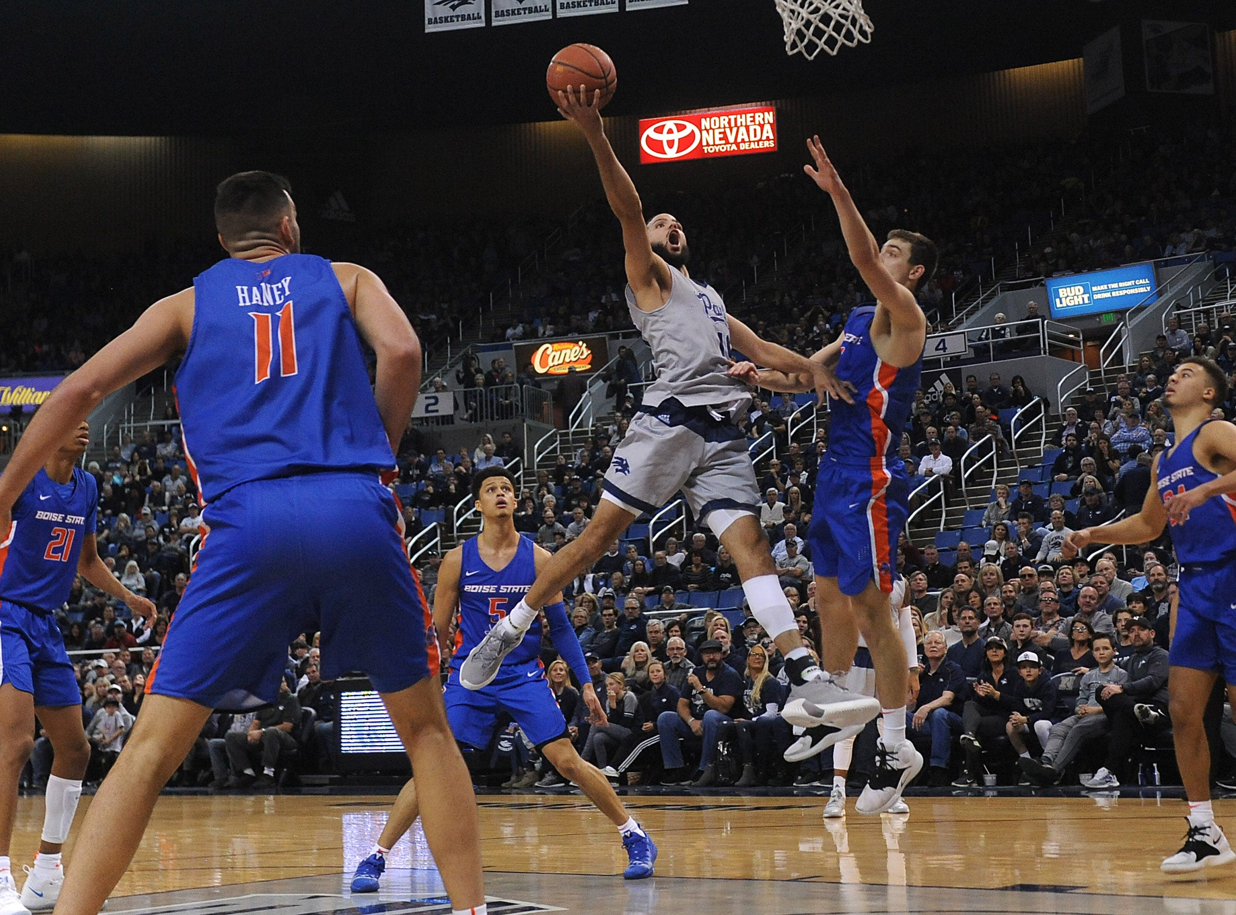 Nevada's Caleb Martin (10) drives to the basket while taking on Boise St. during their basketball game at Lawlor Events Center in Reno on Feb. 2, 2019.