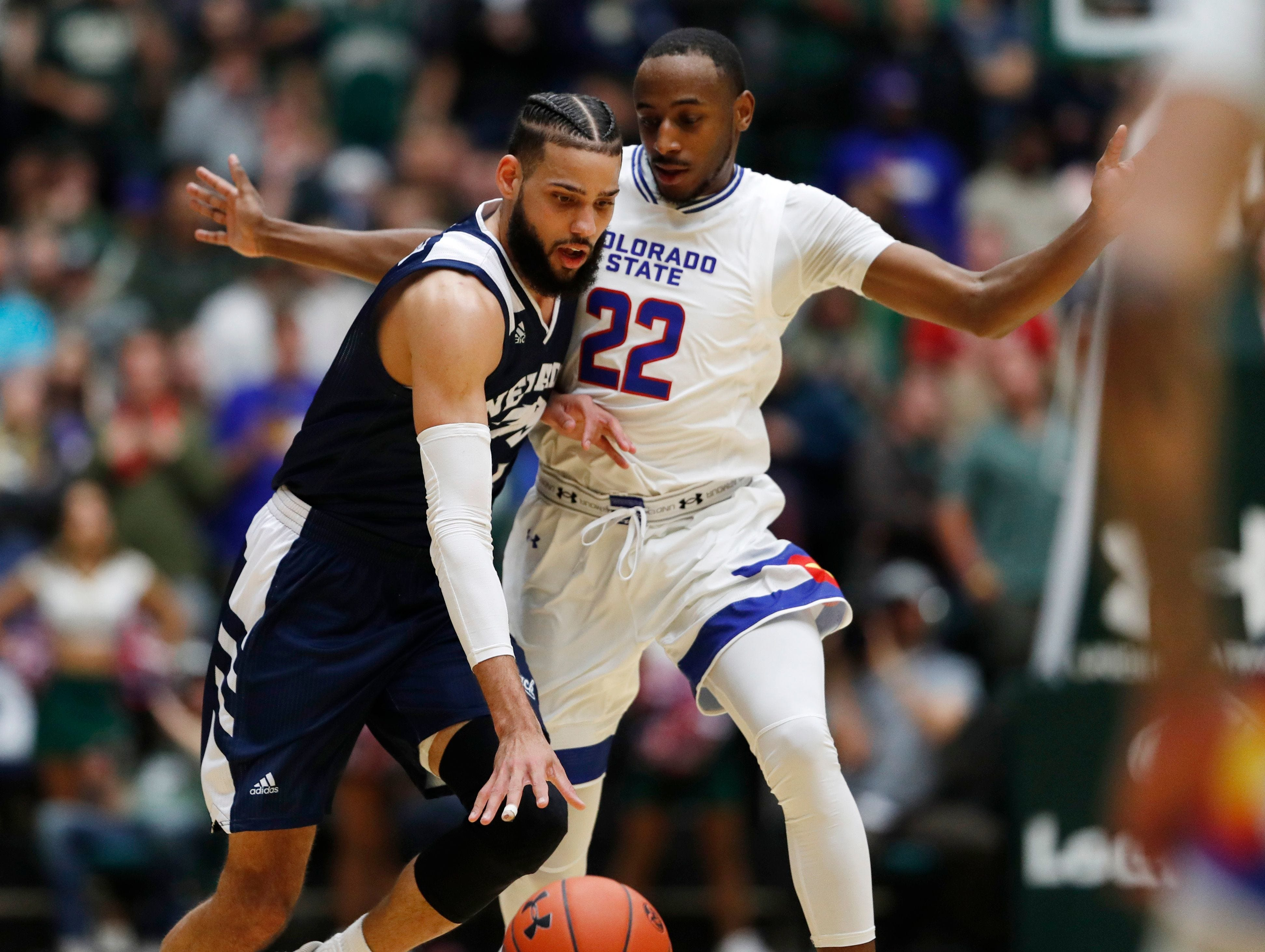 Nevada forward Cody Martin, left, is defended by Colorado State guard J.D. Paige on Feb. 6, 2019, in Fort Collins, Colo. Nevada won 98-82.