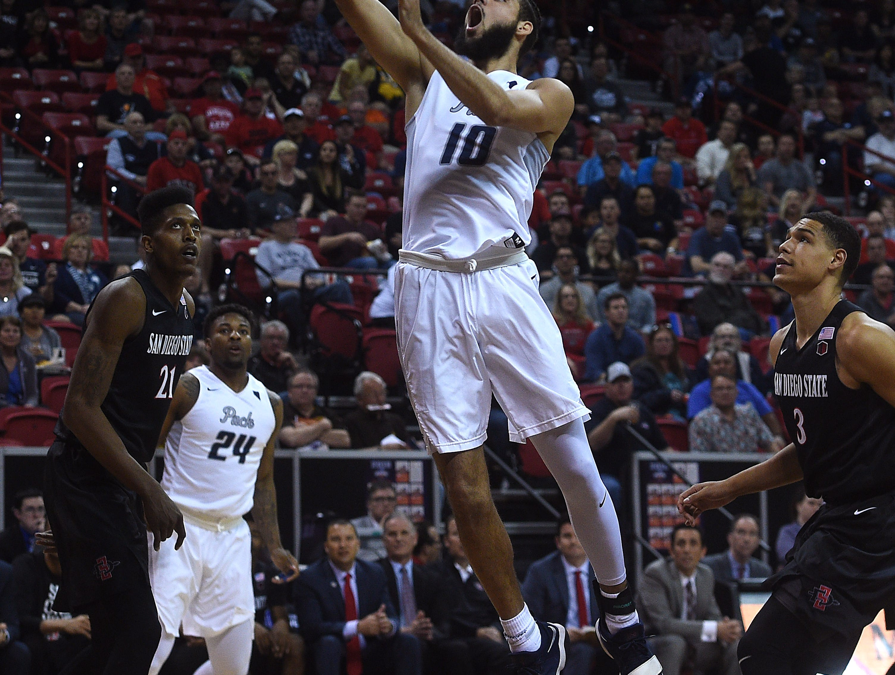 Nevada's Caleb Martin (10) drives to the basket while taking on San Diego State during the Mountain West men's basketball tournament at the Thomas & Mack Center in Las Vegas on March 9, 2018.
