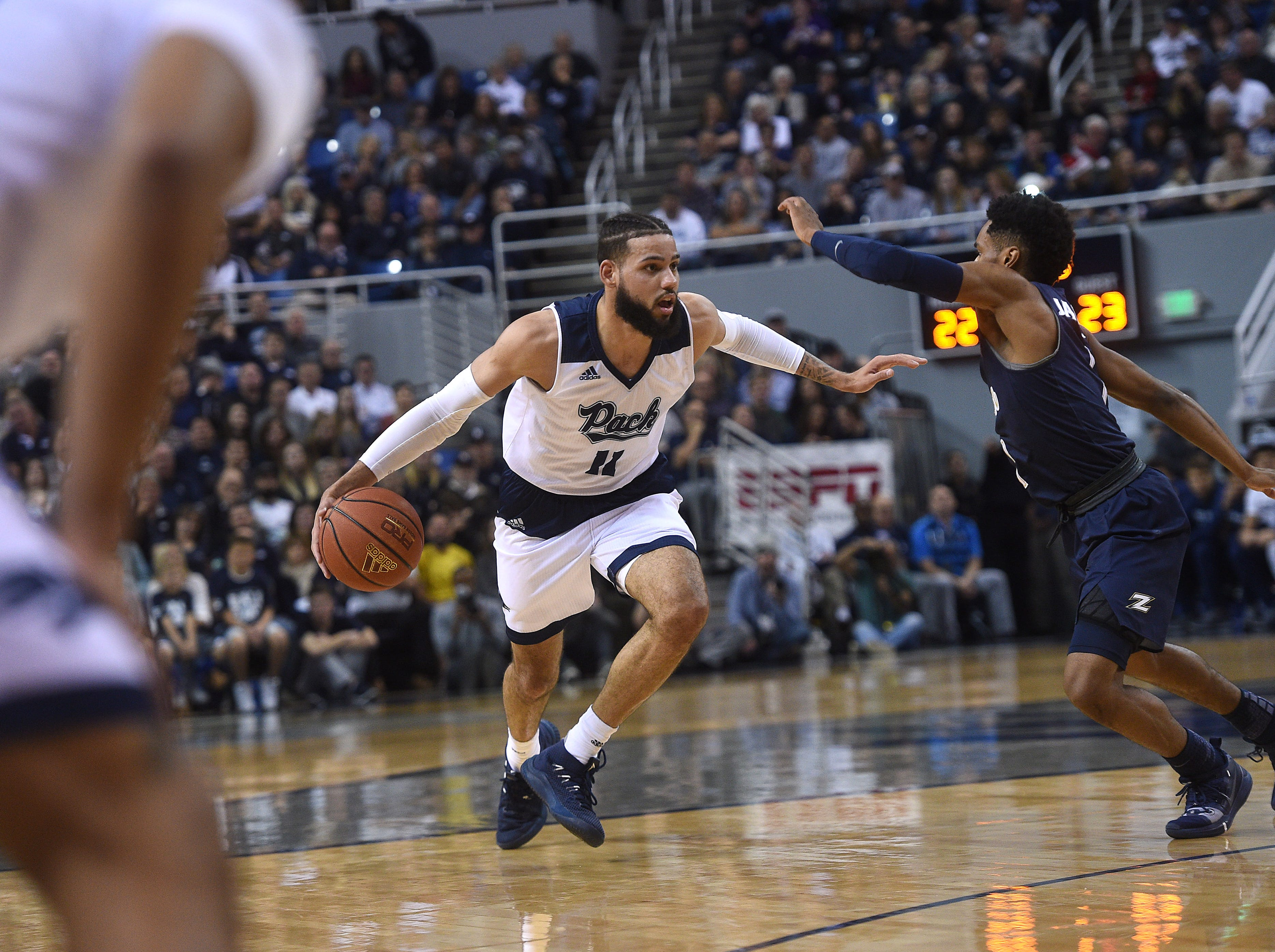 Nevada's Cody Martin (11) brings the ball up court while taking on Akron during their basketball game at Lawlor Events Center in Reno on Dec. 22, 2018.