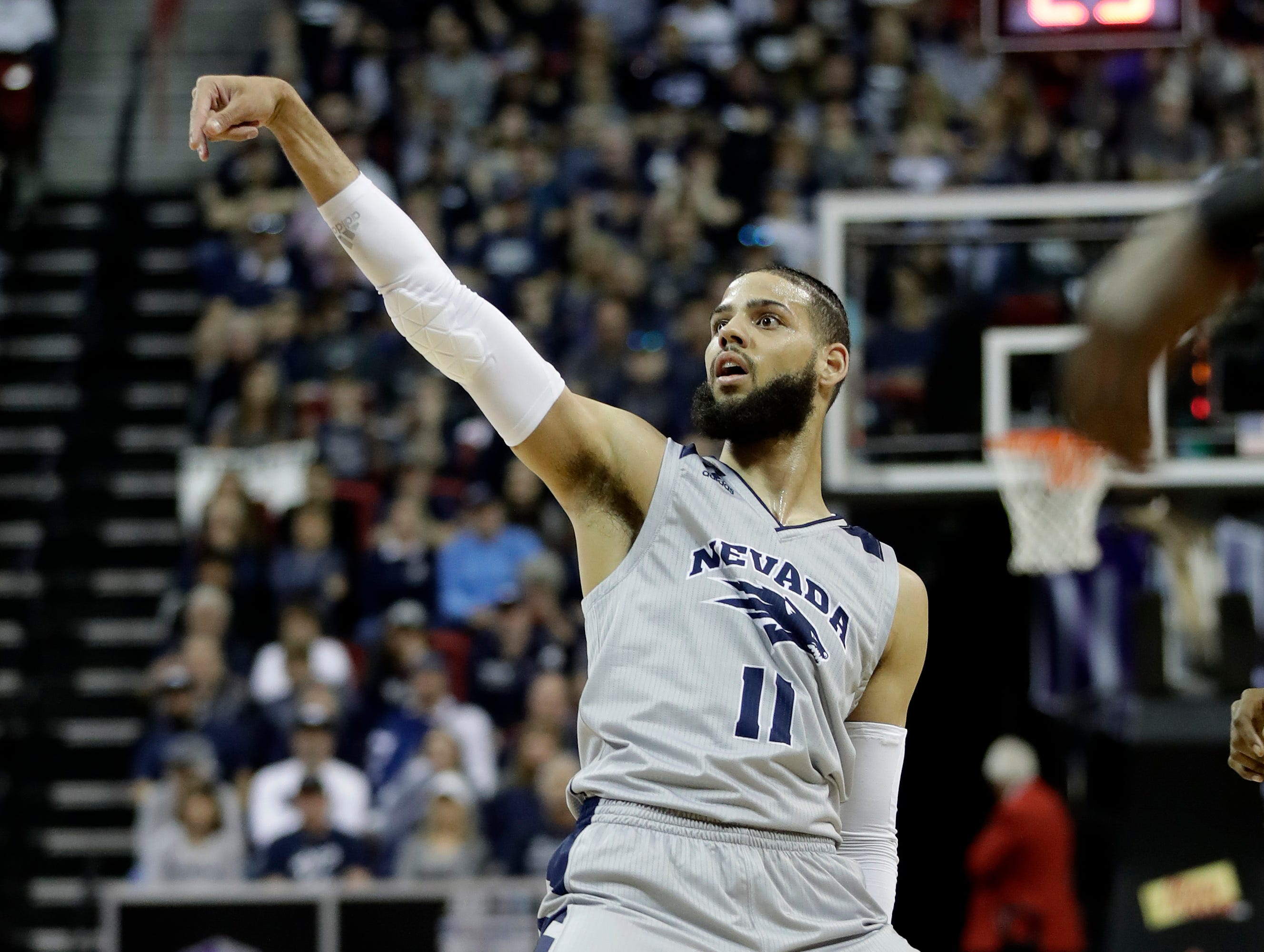 Nevada's Cody Martin watches after his shot during the first half of an NCAA college basketball game against San Diego State in the Mountain West Conference men's tournament Friday, March 15, 2019, in Las Vegas.