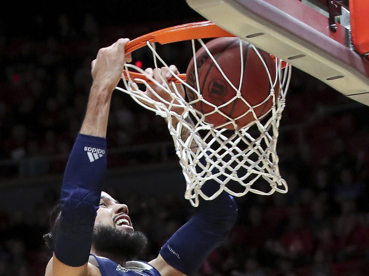 Nevada forward Cody Martin (11) dunks the basketball against Utah during the first half of an NCAA college basketball game, Saturday, Dec. 29, 2018, in Salt Lake City.