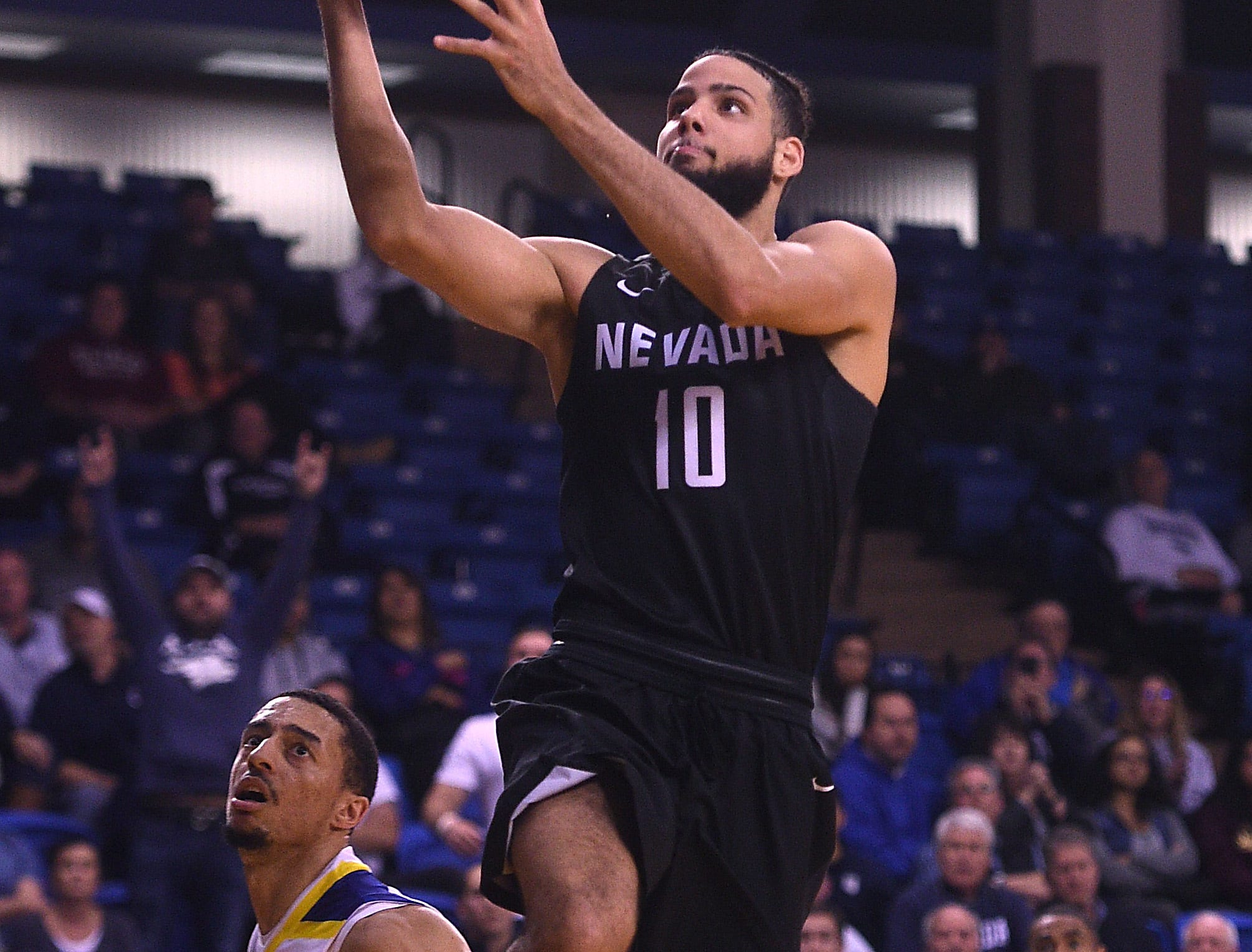 Nevada's Caleb Martin (10) looks to score while taking on San Jose State during their basketball game at the Event Center at San Jose State University on Jan. 17, 2018.