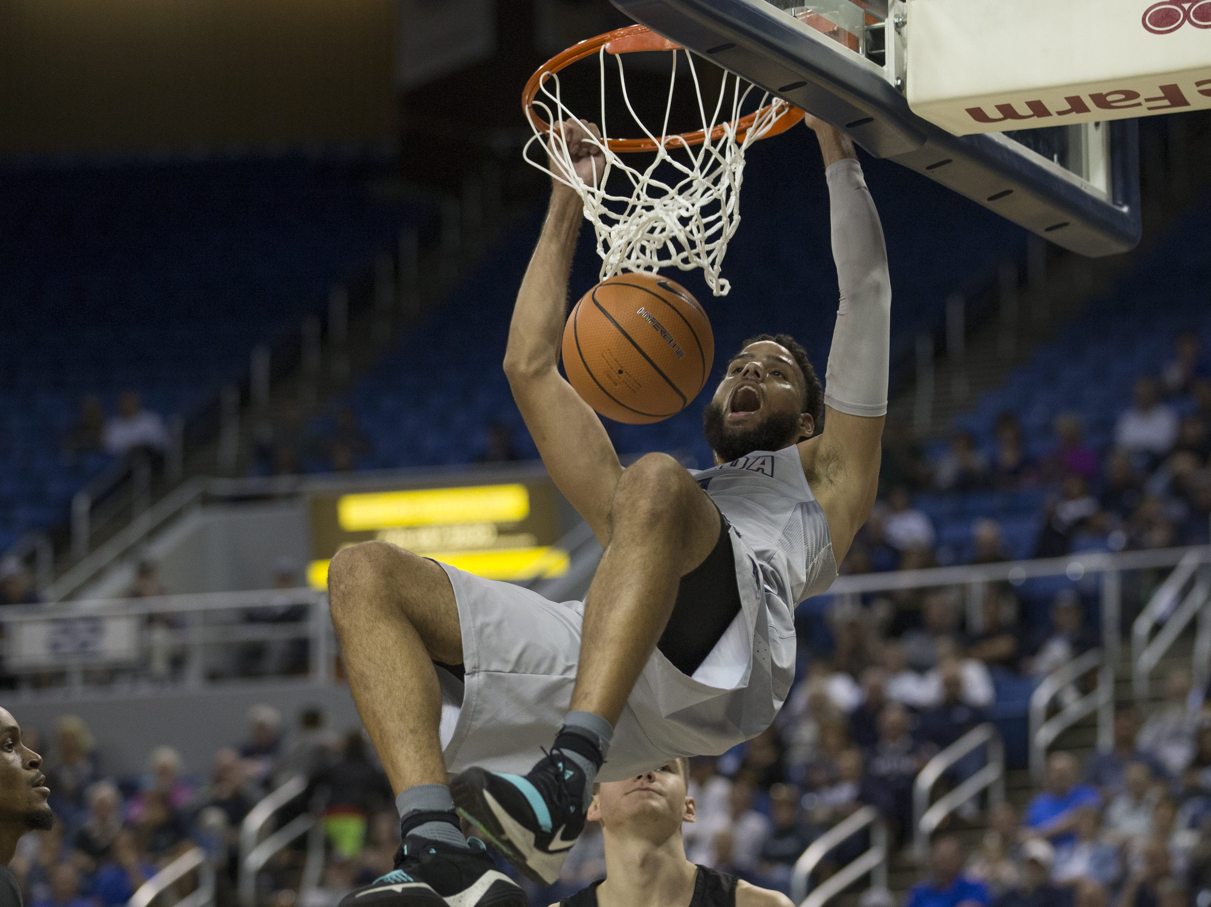 Nevada's Cody Martin dunks the ball against Grand Canyon in their NCAA basketball game held at the Lawlor Events Center on Sunday, Oct. 22, 2017 in Reno, Nevada.