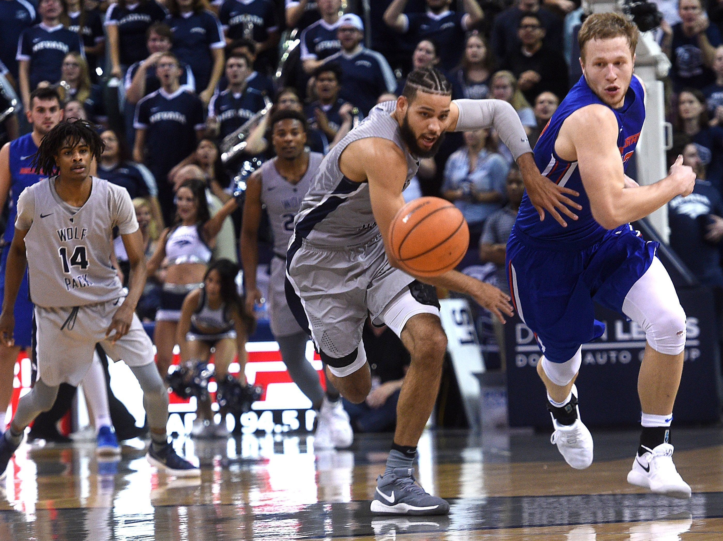Nevada's Cody Martin (11) fights for a loose ball while taking on Boise State during their basketball game at Lawlor Events Center in Reno on Jan. 20, 2018.