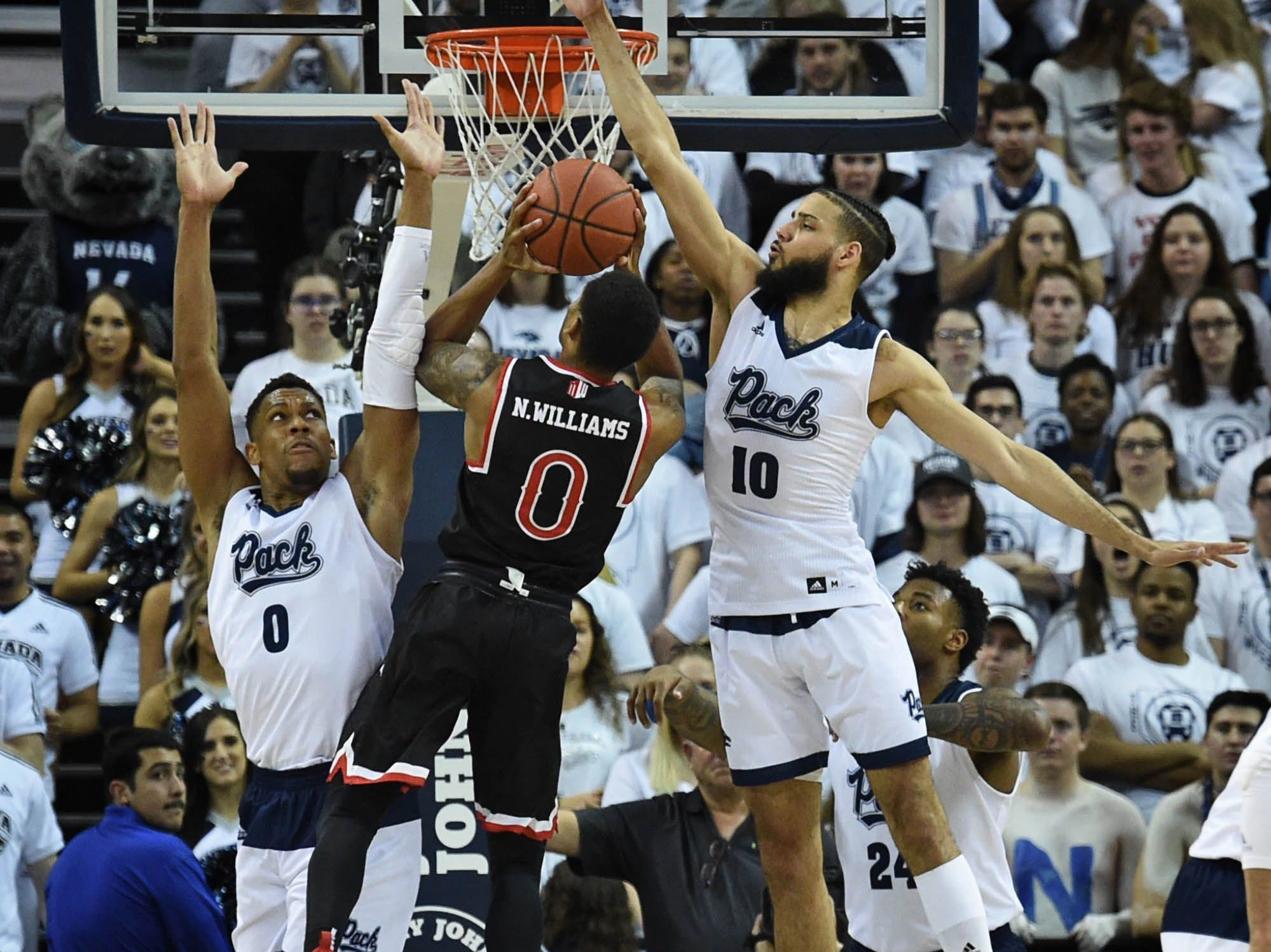 Nevada's Tre' Shawn Thurman, left, and Caleb Martin defend against Fresno State's New Williams at Lawlor Events Center.