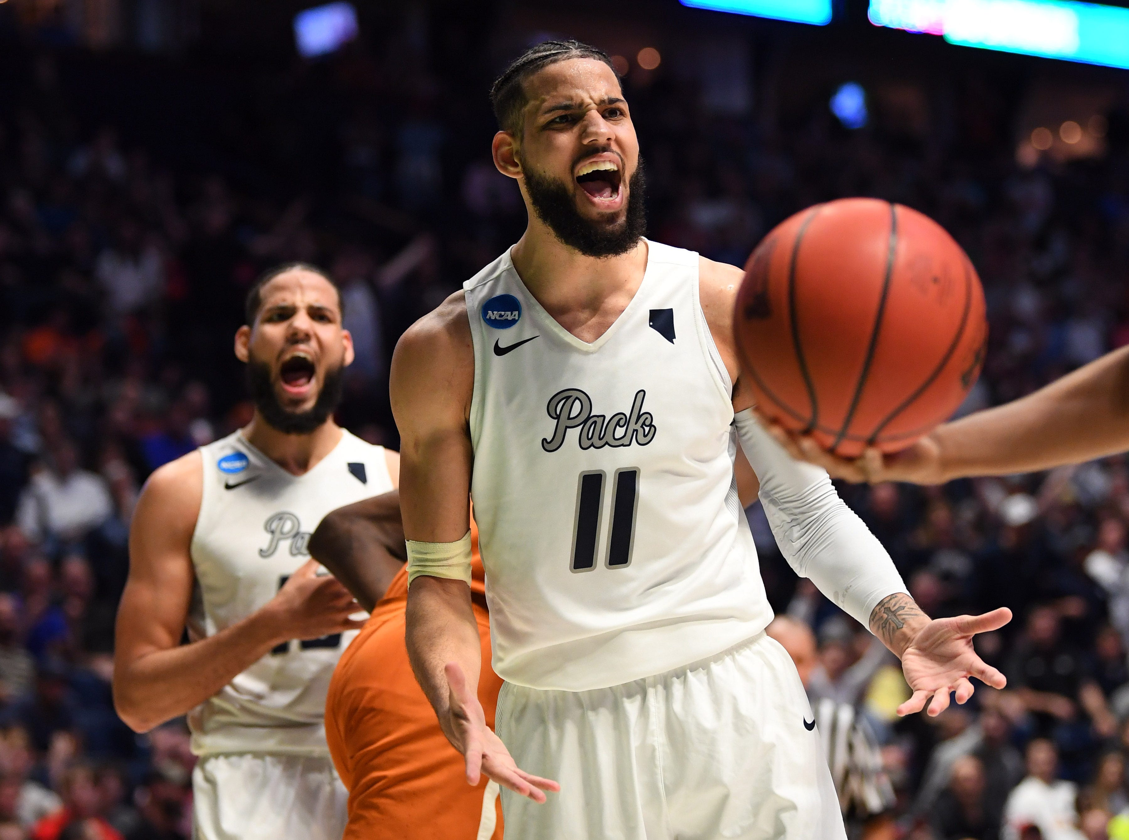 Nevada Wolf Pack forward Cody Martin (11) reacts during the second half against the Texas Longhorns in the first round of the 2018 NCAA Tournament at Bridgestone Arena.