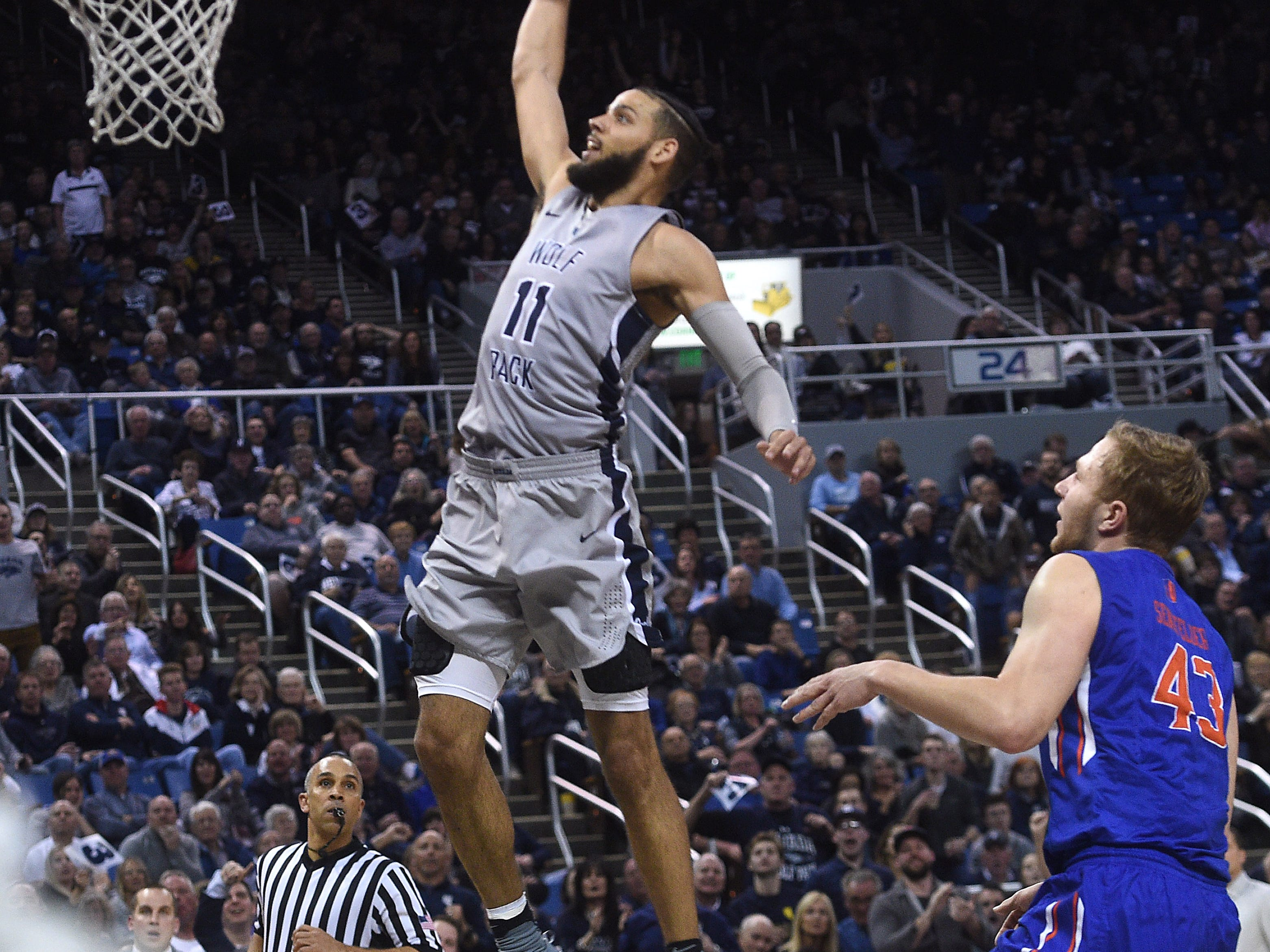 Nevada's Cody Martin (11) dunks while taking on Boise State during their basketball game at Lawlor Events Center in Reno on Jan. 20, 2018.