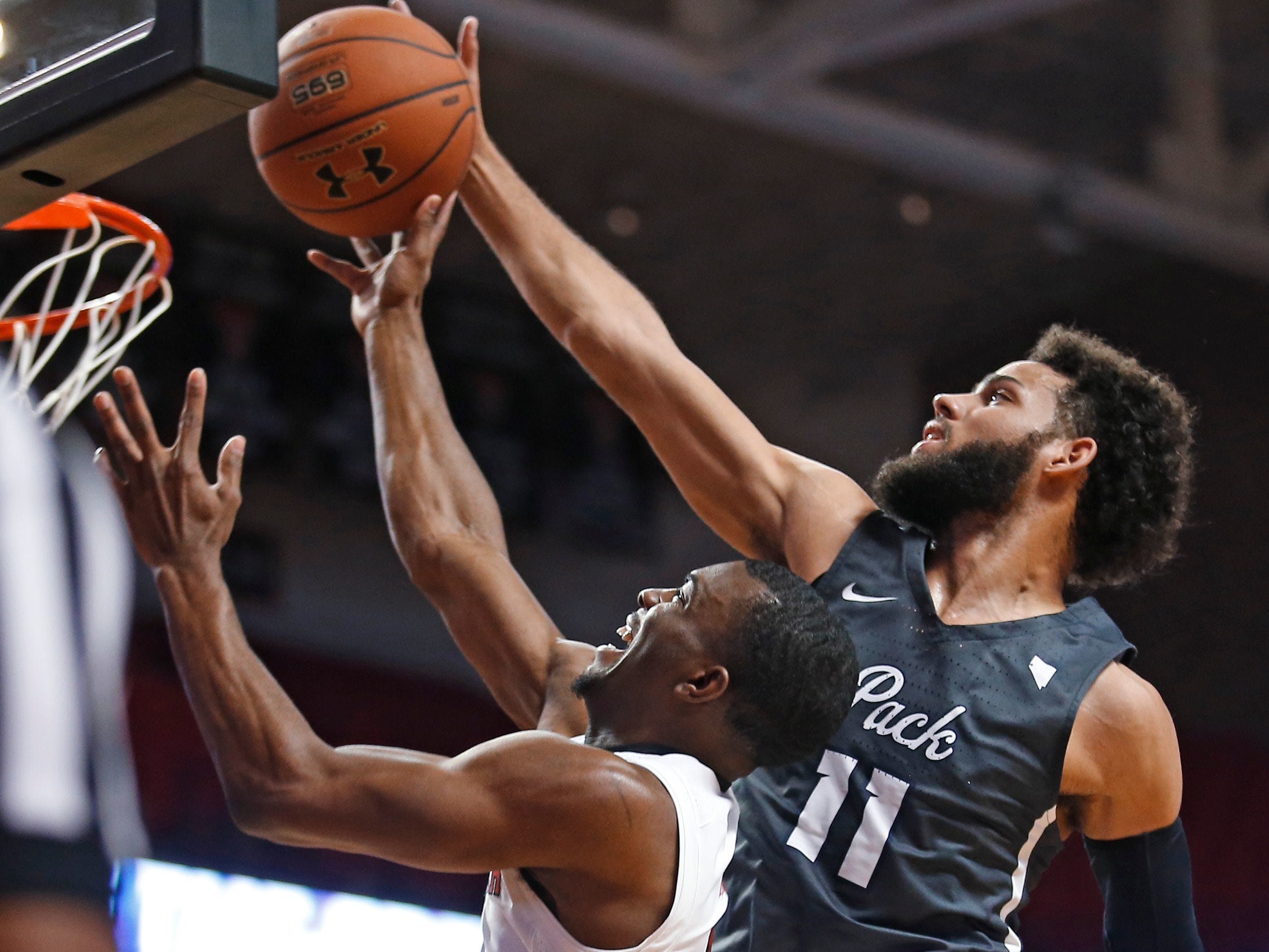 Nevada's Cody Martin tries to block a shot by Texas Tech's Keenan Evans during their game in Lubbock last season.