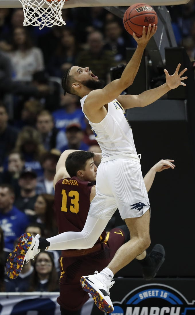 Nevada forward Caleb Martin (10) shoots against Loyola-Chicago guard Clayton Custer (13) during the second half of a regional semifinal NCAA college basketball game, Thursday, March 22, 2018, in Atlanta.