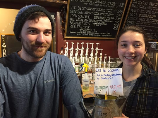 At Cricket's in Geneseo, Kelsey Thompson started a   poll about whether hot dogs are sandwiches. Emma Schneider holds the tip jar with the hot dog vote.