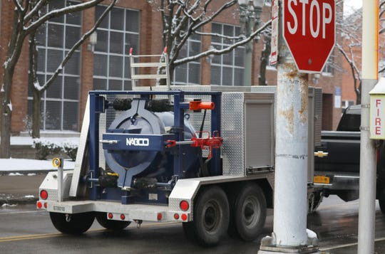 Rochester Police Department's bomb squad races their containment vehicle away from the scene after they removed a suspicious package from in front of the Federal Building in downtown Rochester Monday morning, March 19, 2019.
