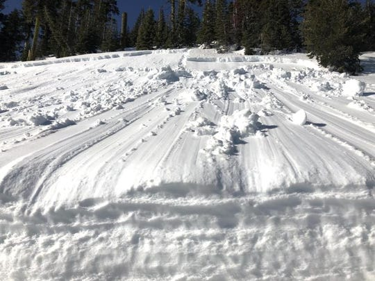 The bed surface of the avalanche hit Everitt Memorial Highway below Bunny Flat at the 6,800-foot level of Mt. Shasta.