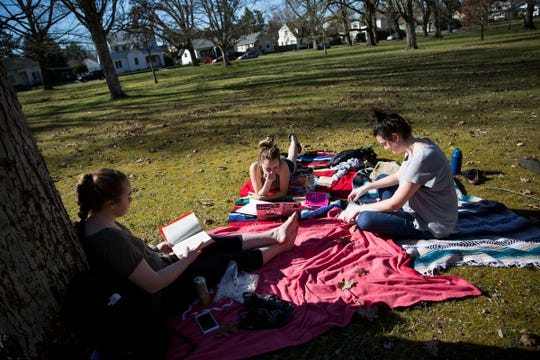Roommates Kaitlyn Donaldson, Rashelle Stricklin and Morgan Dunn study and read at Bush's Pasture Park in Salem on March 18, 2019. Temperatures reached into the 70s.
