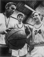 Stayton High School coach Don Carey works with two players in 1971.