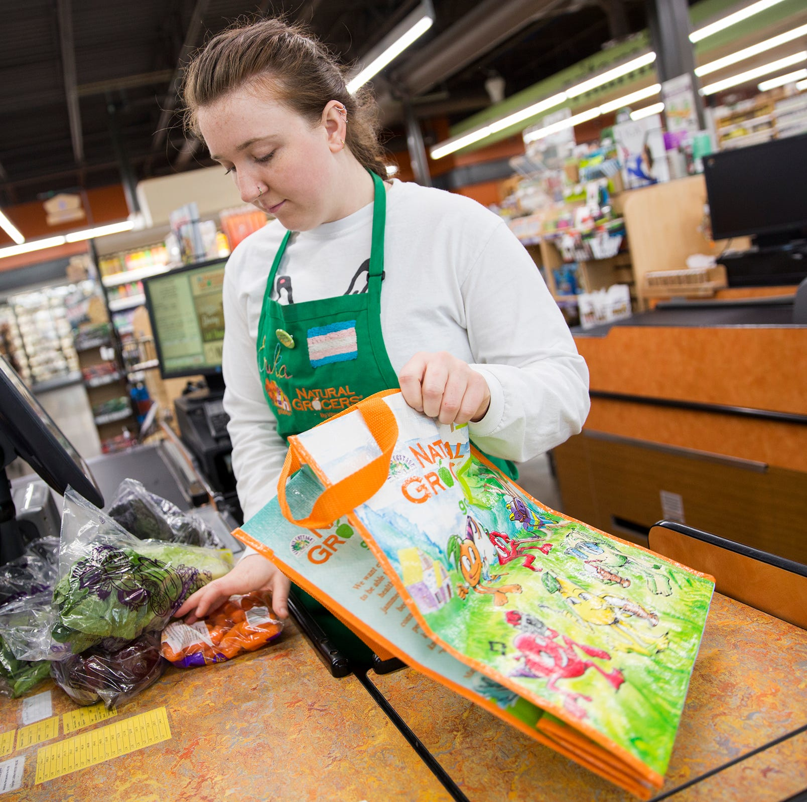 Salem plastic shopping bag ban gets mixed reviews; paper bags cost at least 5 cents each