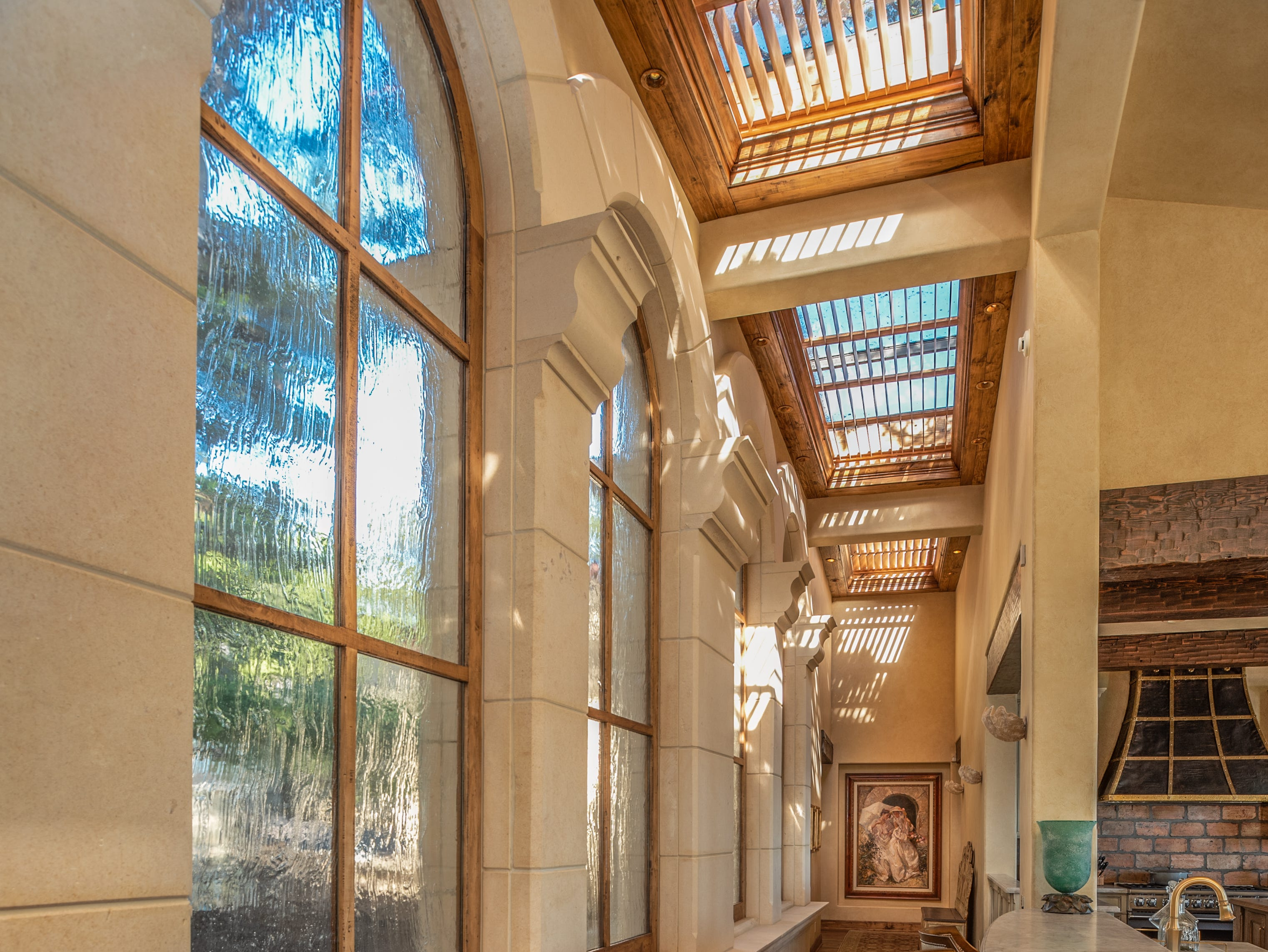 The skylights and arched windows bring the sunlight in.