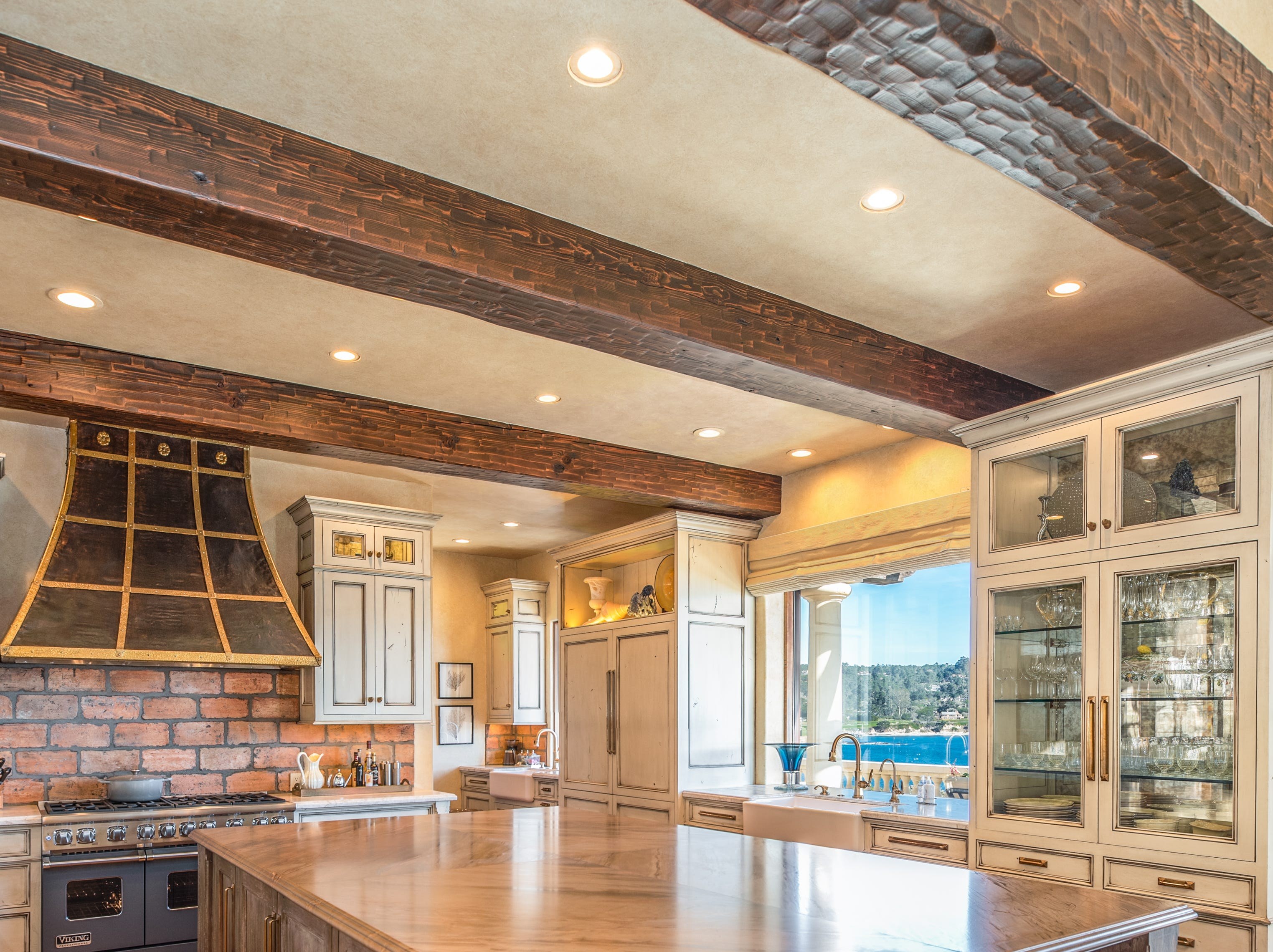 An ample island graces the center of the kitchen, providing storage, counter space and seating.