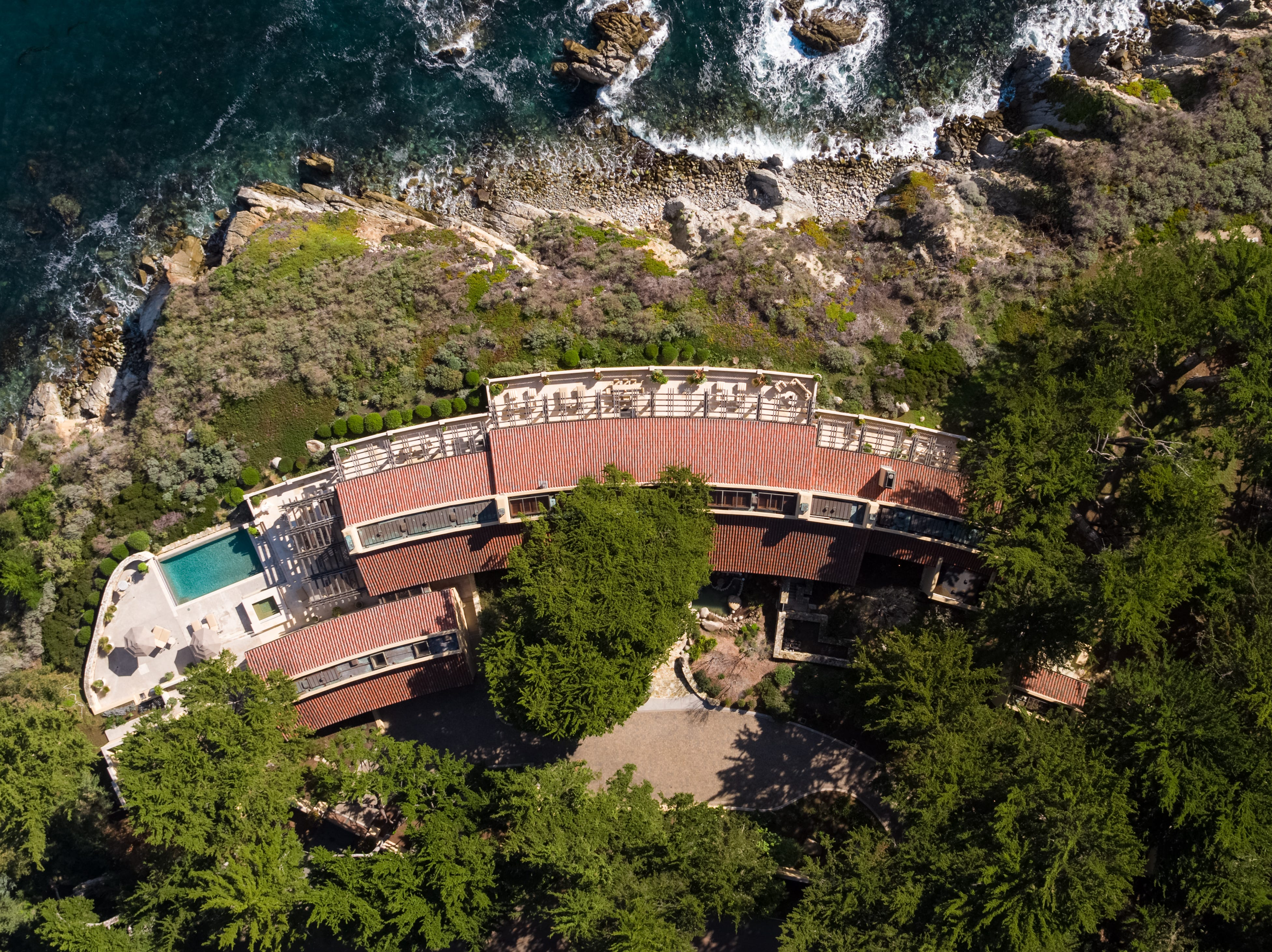 An aerial view of the 8,412-square-foot home showcases its bowed footprint, to take full advantage of the lot and the Monterey Bay view.