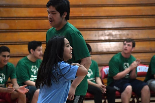 North Salinas' Mia Sablano celebrates a basket in Monday's Unified Basketball League game.
