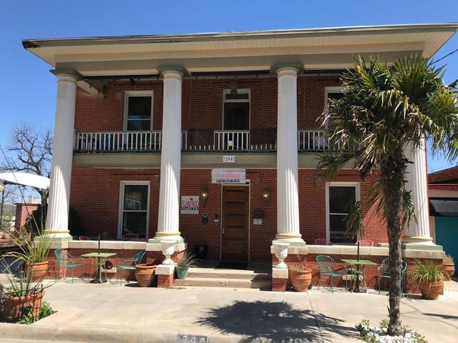 Flamingo Flatts, a hotel in downtown San Angelo, is up for sale by owners Toni Hunter and Phyllis Cox.