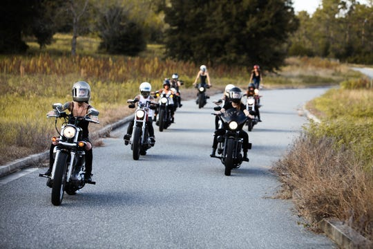 Members of the Iron Lilies, an all-women motorcycle club based in Florida, enjoy a ride.