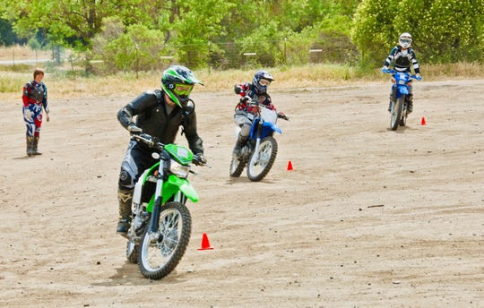 Riders participate in a Women's Motorcyclist Foundation's Dual Sport and Adventure Riding Training Camp.