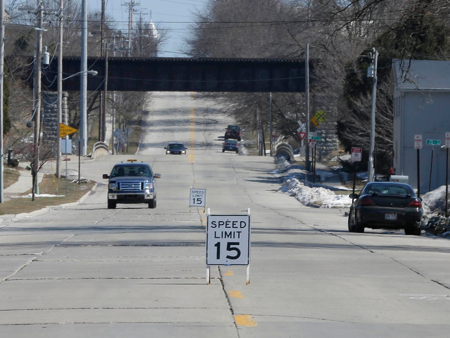 Reduced speed limit signs are up near the flooding along New Jersey Avenue, Tuesday, March 19, 2019, in Sheboygan, Wis.