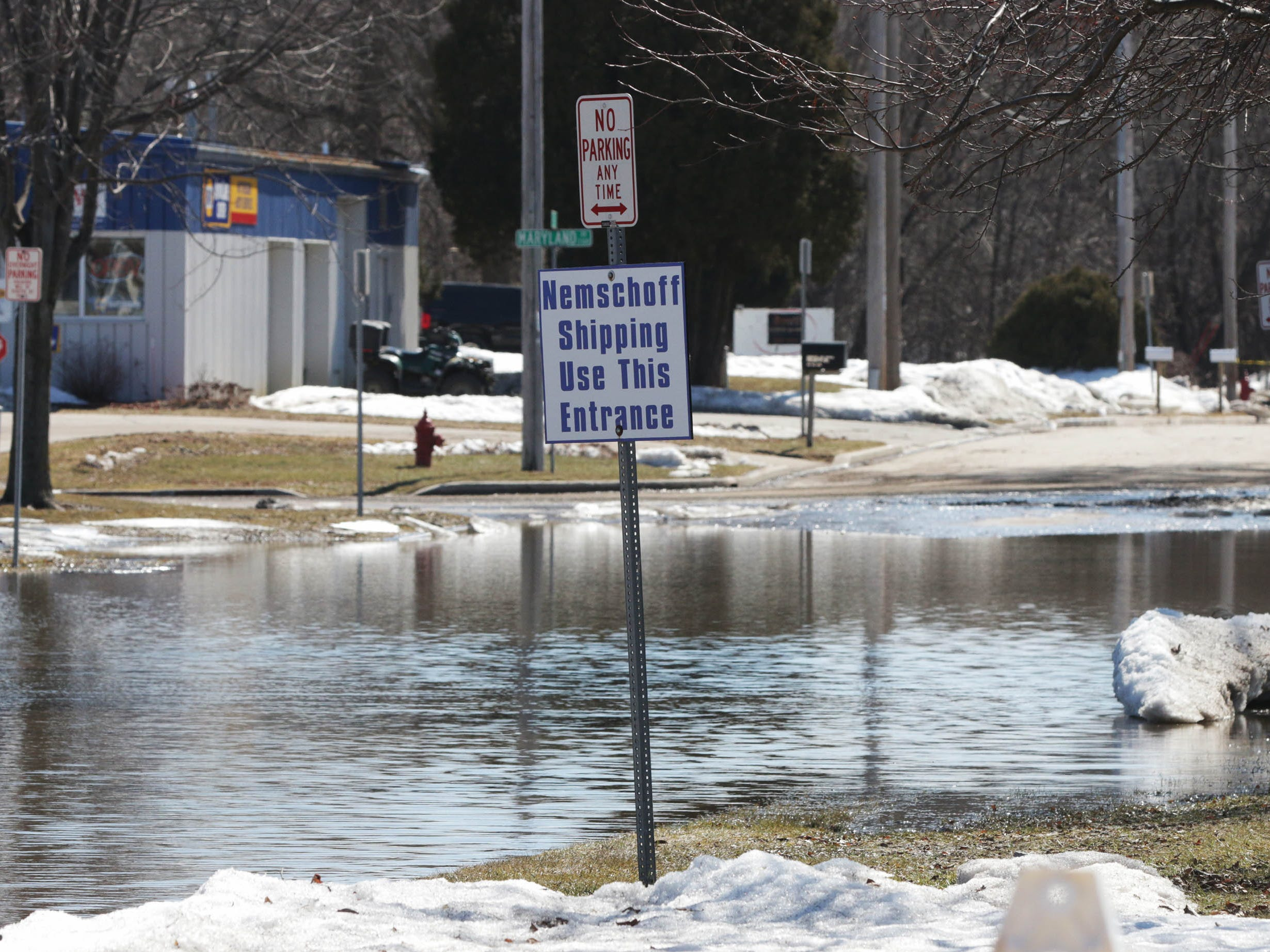 North 22nd Street, which leads to Nemschoff is closed while the city waits for the water to subside from flooding, Tuesday, March 19, 2019, in Sheboygan, Wis.