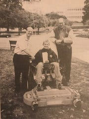 Communications specialist for Kohler Co. Todd Weber, Ryan Tripp and Robert Walker, president of Walker Mfg. Co. who donated the mower for Tripp's journey in Washington D.C. -- Oct. 15, 1997