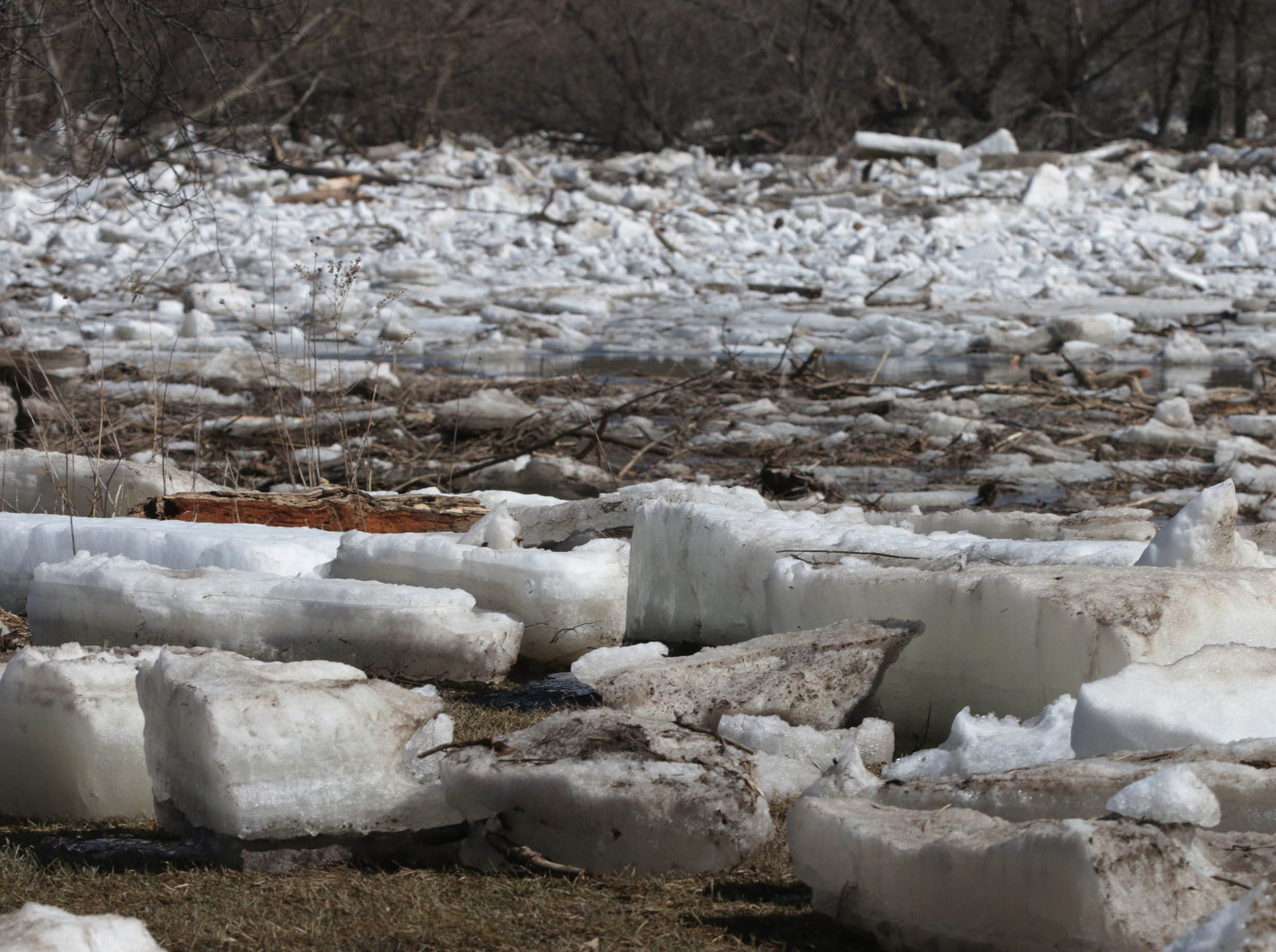 Ice slabs cover the parking lot and land near Nemschoff, Tuesday, March 19, 2019, in Sheboygan, Wis.