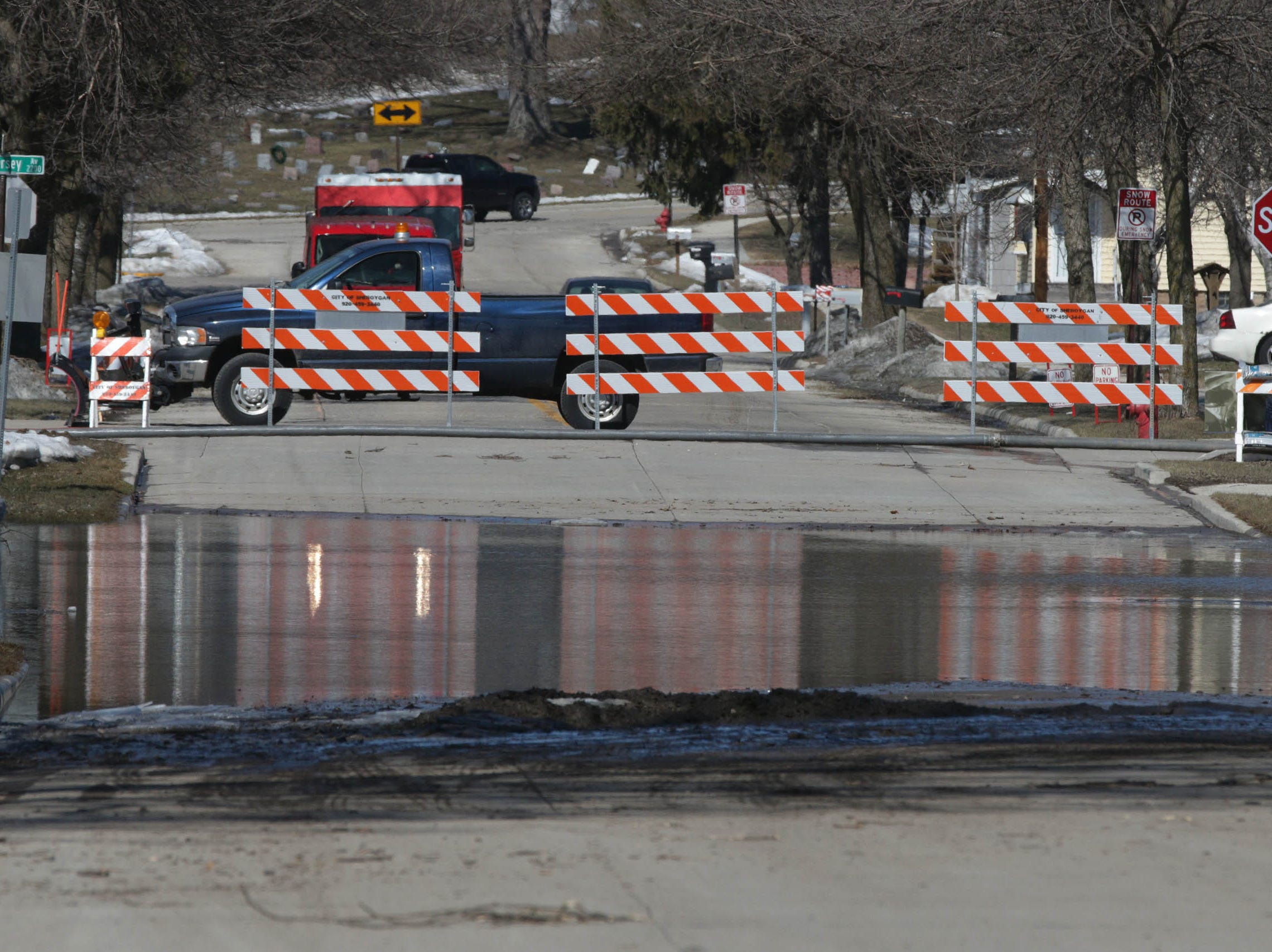 North 22nd Street is closed near New Jersey, Tuesday, March 19, 2019, in Sheboygan, Wis.