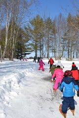 Grant Elementary School kindergarten students explore Maywood Environmental Park during a winter field trip.