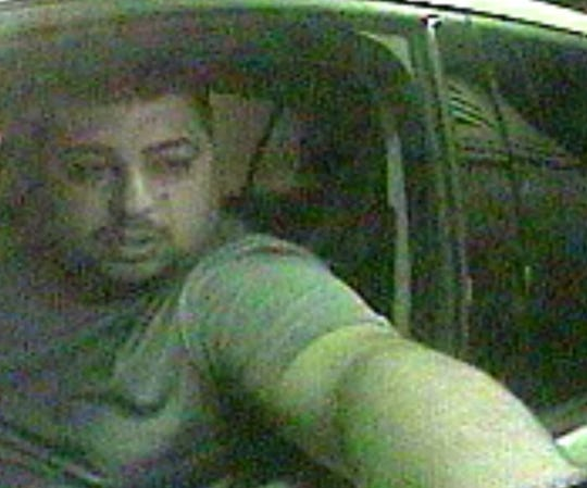 A suspect in the credit-debit card theft is seen on surveillance camera.