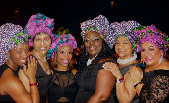 Head wraps were popular additions to formal wear at Krewe Harambee Maskhara Bal XIX. Modeling their versions: Bree Carroll, Terri  Hatten, Melanie Spencer, Renata Mahoney, Daphne Thibeaux, Sherry Gill.