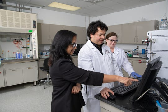 Drs. Sudha Garg and Rachid Nazih and Technician Tracy Ash working in the current center's radiopharmaceutical research lab.