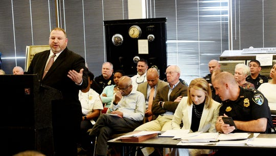 Michael Carter told the Fire and Municipal Civil Service Board multiple times Tuesday that he's not resigning from his position as chairman during a special meeting.